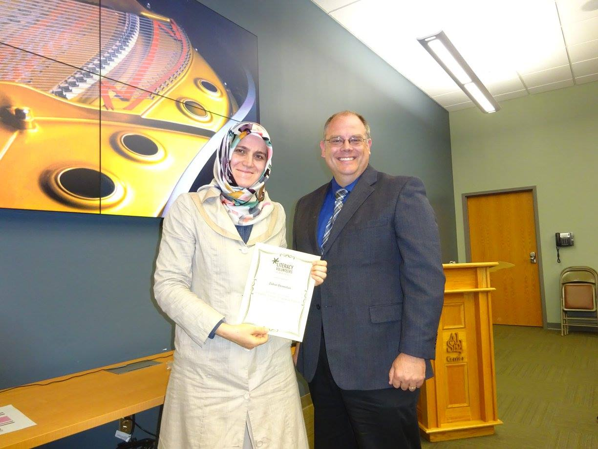 LVR Board Member Dave Adams presents a recognition certificate to Zuhal Demirtas